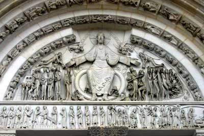 The tympanum of the portal of the Church of Mary Magdalene in the Abbey of Vezelay (Vézelay), the Department of Yonne (Yonne, France.
