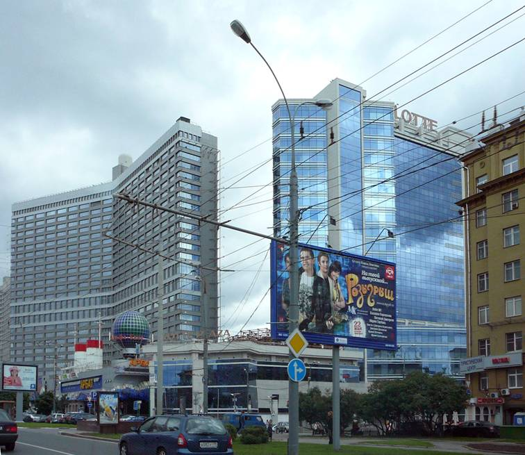 "In 1960s Mikhail Posokhin-father erected Novy Arbat. In the 2000's Michael Posokhin-son has attached to Novy Arbat's ""books"" another high-rise building. Again, it is symbolically, and one more skyscraper in the center..."