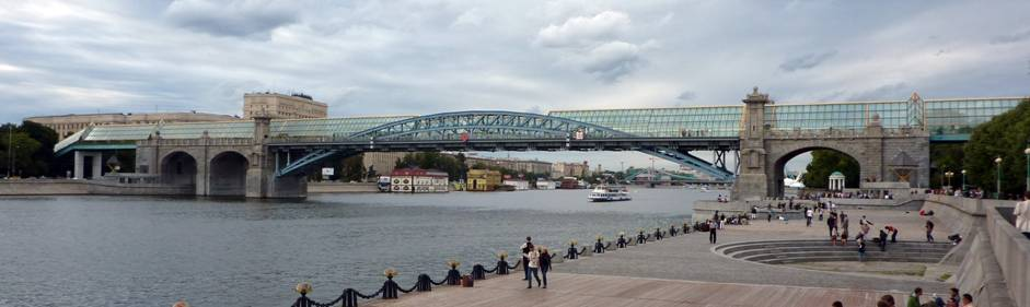 "However, Andreevsky Bridge survived, was moved downstream of the Moscow River and made pedestrian. But unique Pomerantsev's arch disappeared under the glass ""caterpillar"" (architect Yury Platonov)."