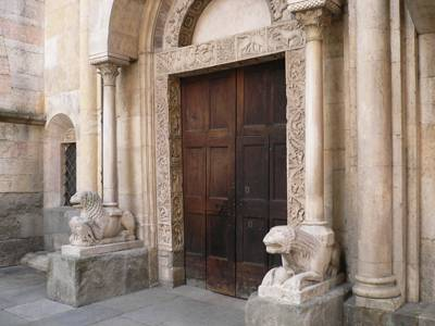 Lions near the portal of the Romanesque cathedral in Modena.